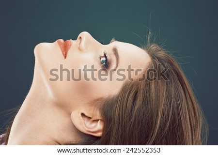 Close up face portrait of young woman. Female model studio posing.