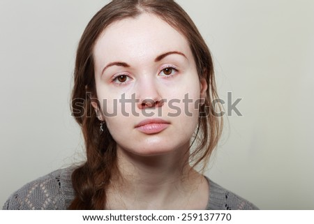 Close-up face portrait of young woman without make-up. Natural image without retouching, shallow depth of field. - stock photo