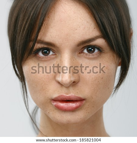 Close-up face portrait of young woman without make-up. Natural image without retouching w/shallow depth of field. - stock photo