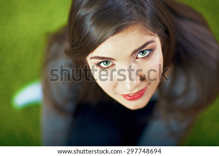 Close up face portrait  with small depth of field.Young smiling woman. Beautiful eyes. Long hair. - stock photo