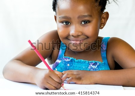 Close up face shot of african kid holding red pencil.Isolated on white background.