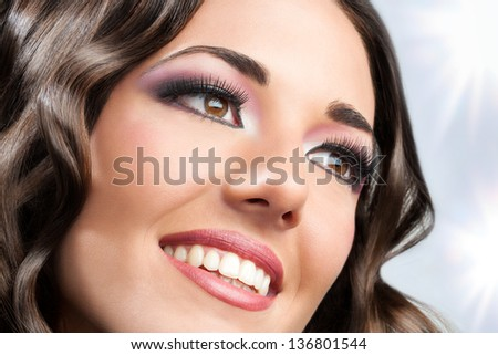 Close up face shot of beauty brunette smiling. - stock photo