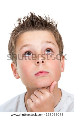 Close up face shot of cute boy looking up.Isolated on white. - stock photo