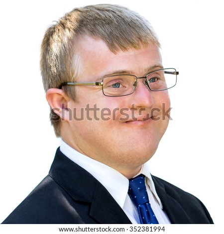 Close up face shot of young businessman with down syndrome. Handicapped man in suit isolated against white background.
