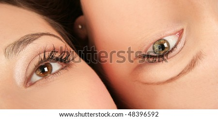 close-up faces of beautiful women - stock photo