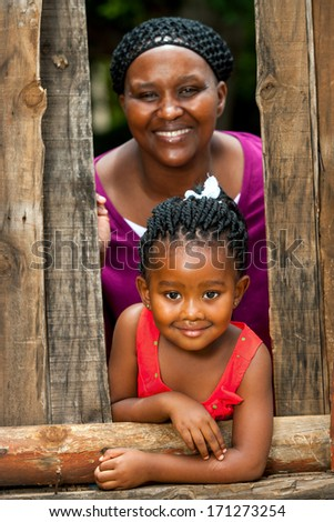 Close up family portrait of african mother with daughter outdoors. - stock photo