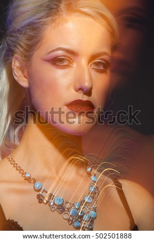 Close Up Fashion Art Photo Of Elegant Young Blonde Natural Beauty Model With Streaking Lights Wearing Jewelry At A Party. Light Effects.