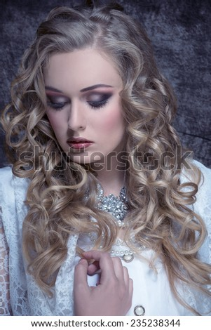 close-up fashion portrait of sensual  blonde woman with long curly hair, stylish make-up and vintage aristocratic style.