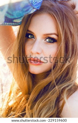 Close up fashion portrait of young beautiful sensual woman with bright make up and long amazing hairs, posing at evening sunlight. - stock photo