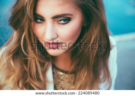 Close up fashion portrait of young pretty tender sensual woman with perfect skin bright make up and amazing fluffy hairs. Bright vintage toned colors. - stock photo