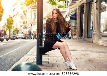 Close-up Fashion woman portrait of young pretty trendy caucasian girl posing at the city in Europe,summer street fashion with lovely sun backlight background