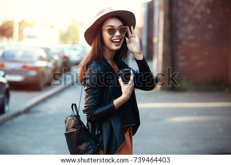 Close-up Fashion woman portrait of young pretty trendy girl posing at the city, autumn street fashion. laughing and smiling portrait.trendy