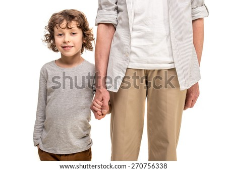 Close-up. Father and son holding hands, isolated a white background. - stock photo