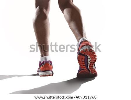 close up feet with running shoes and female strong athletic legs of sport woman jogging in fitness training workout design in advertising poster style isolated white background - stock photo