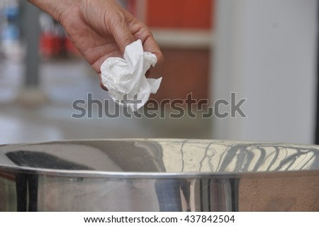 Close-up Female tourist 's Hand throwing scarp of paper into recycling bin, concept of environmental protection, Keep clean, Littering of environmental. - stock photo