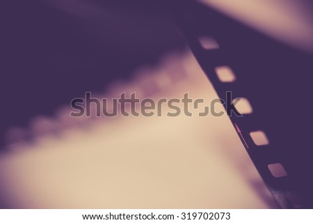 Close-up Film of a roll 35 mm photographic film; vintage tone style,soft focus