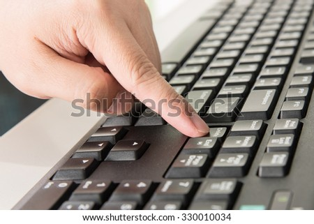 Close up finger pressing delete on keyboard - stock photo