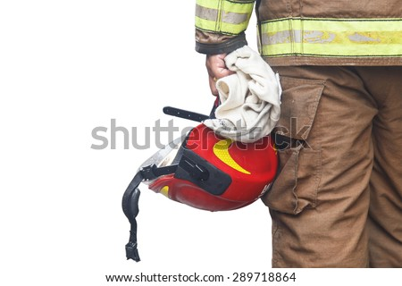 Close up firefighter holding red safety helmet isolated on white background - stock photo