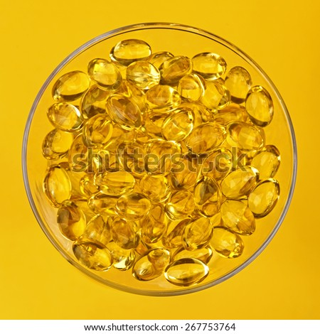 Close-up fish oil nutritional supplement capsules - stock photo