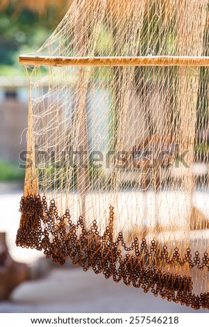 Close up fishing net against sun light with blur background - stock photo