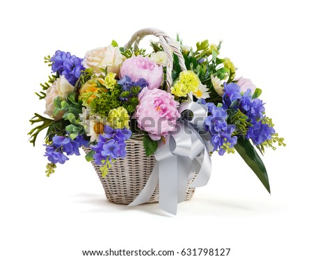 close up flower bouquet arrangement in wicker basket isolated on white carnation rose