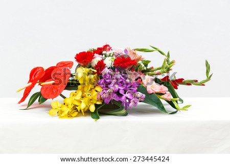 Close up flower bouquet on table, Close up flower bouquet on table, vanda, gerbera, chrysanthemum, orchid, Pong pong seeds, Anthurium, Flamingo - stock photo