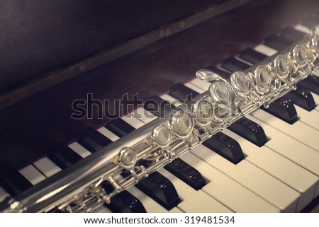 close up flute on piano on vintage style