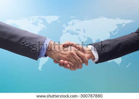 close up focus business man handshake on blurred colorful background:official adult man in suit outstretched arm hand shake togetherness for agreement in promise success concept:partner/colleagues  - stock photo