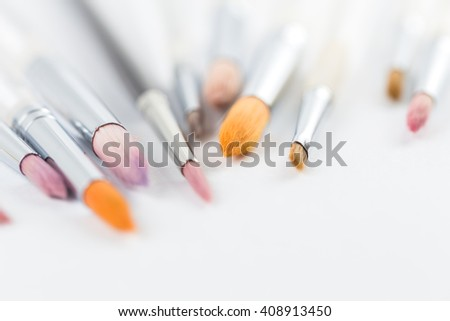 Close up focus on paintbrushes isolated on white paper background