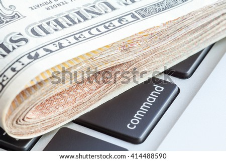 Close-up folded of US dollars banknotes on command sign, Business concept.