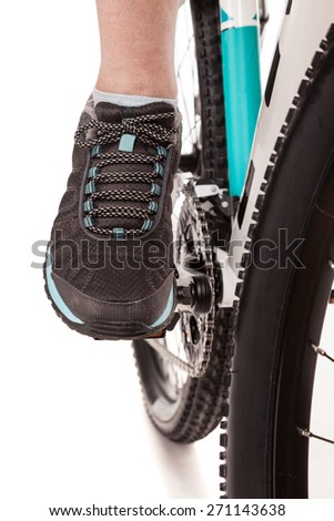 Close up foot of the cyclist pedaling bike - stock photo