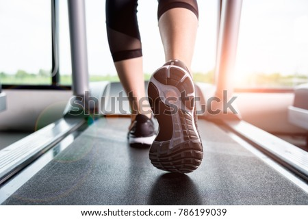 stock-photo-close-up-foot-sneakers-fitne