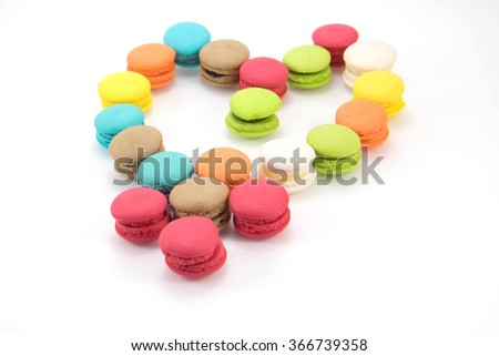 Close up French colorful macarons on white background