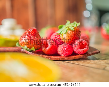 Close-up fresh red strawberry put on the table.Ripe red strawberries is delicious.Sweet red berry Spread on the table Raspberries appetizing,selective focus on red strawberry. - stock photo