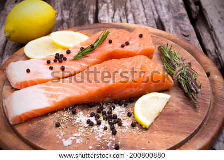 Close up Fresh salmon with spices on old wood
