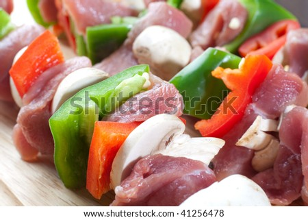 Close up freshly made meat sticks with veggies and pork meat - stock photo