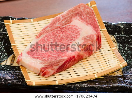 Close up Freshness Marbled on Japanese Kobe Matsusaka Beef for BBQ On The Plate in Restaurant  , King of Beef - stock photo