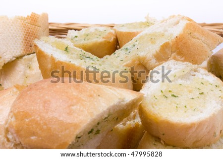 Close up from low viewpoint of basket of Garlic bread. - stock photo