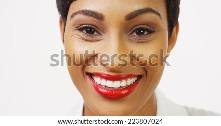 Close up front view of pretty black woman with red lipstick smiling - stock photo