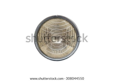 Close up front view of round car headlight, isolated on white background. - stock photo