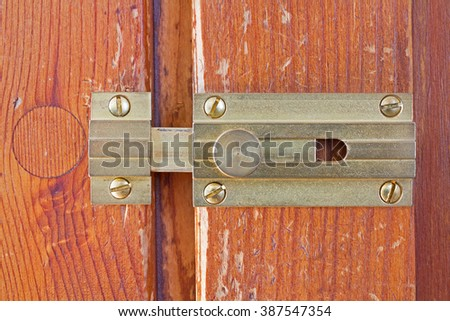 Close-up frontal shot of a latch on a wooden door - stock photo