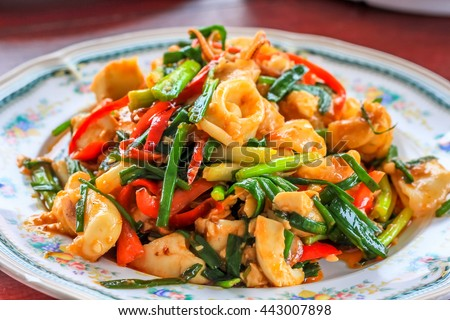 close up fry seafood curry squid shrimp crabs on the plate - stock photo