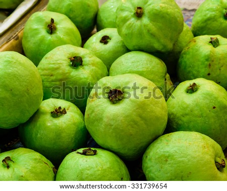 Close-up, full frame view of bunch of fresh organic ripe guavas at the fruit stall in the wet market of Little India, Singapore