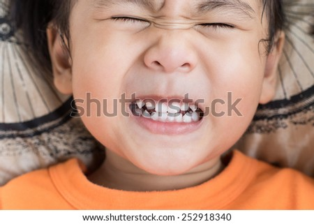 close up funny face of children toothy acting  - stock photo