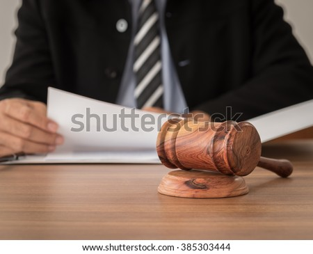 Close up gavel judge  with lawyer working at courtroom. - stock photo