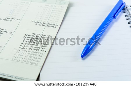 close up general thailand book bank and single blue pen with note book - stock photo