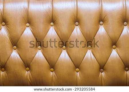 Close up genuine leather upholstery background  - stock photo