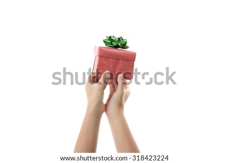 Close up gift box in kids hand isolate on white background. - stock photo