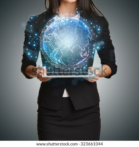 Close up Girl holding a digital globe over tablet.