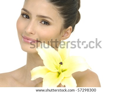 Close up girl holding lily flower in her hands - stock photo